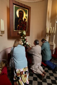 Local women worship at the Black Madonna Chapel, Saint Stephen's Basilica, Budapest